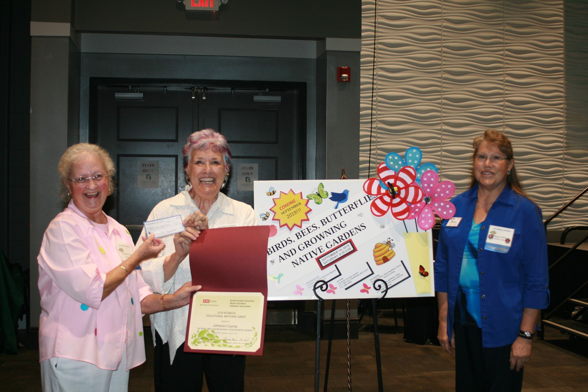 Johnston County Master Gardener Marjean Telke Center Accepts The Ncemgva Educational Matching Grant From Awards Co Chairs Brenda Clayton Left